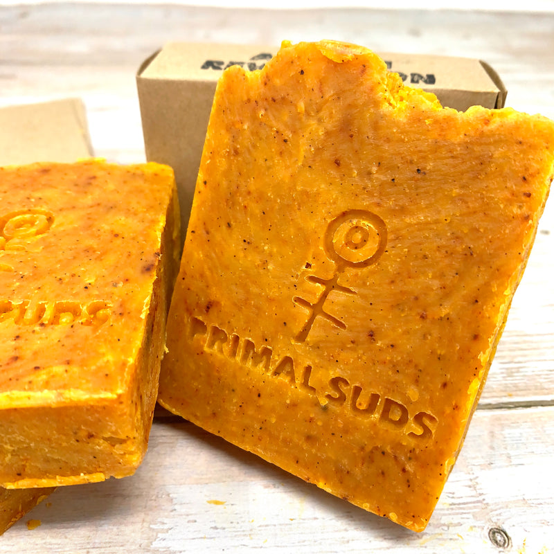 orange soap bar with annetto seeds by primal suds