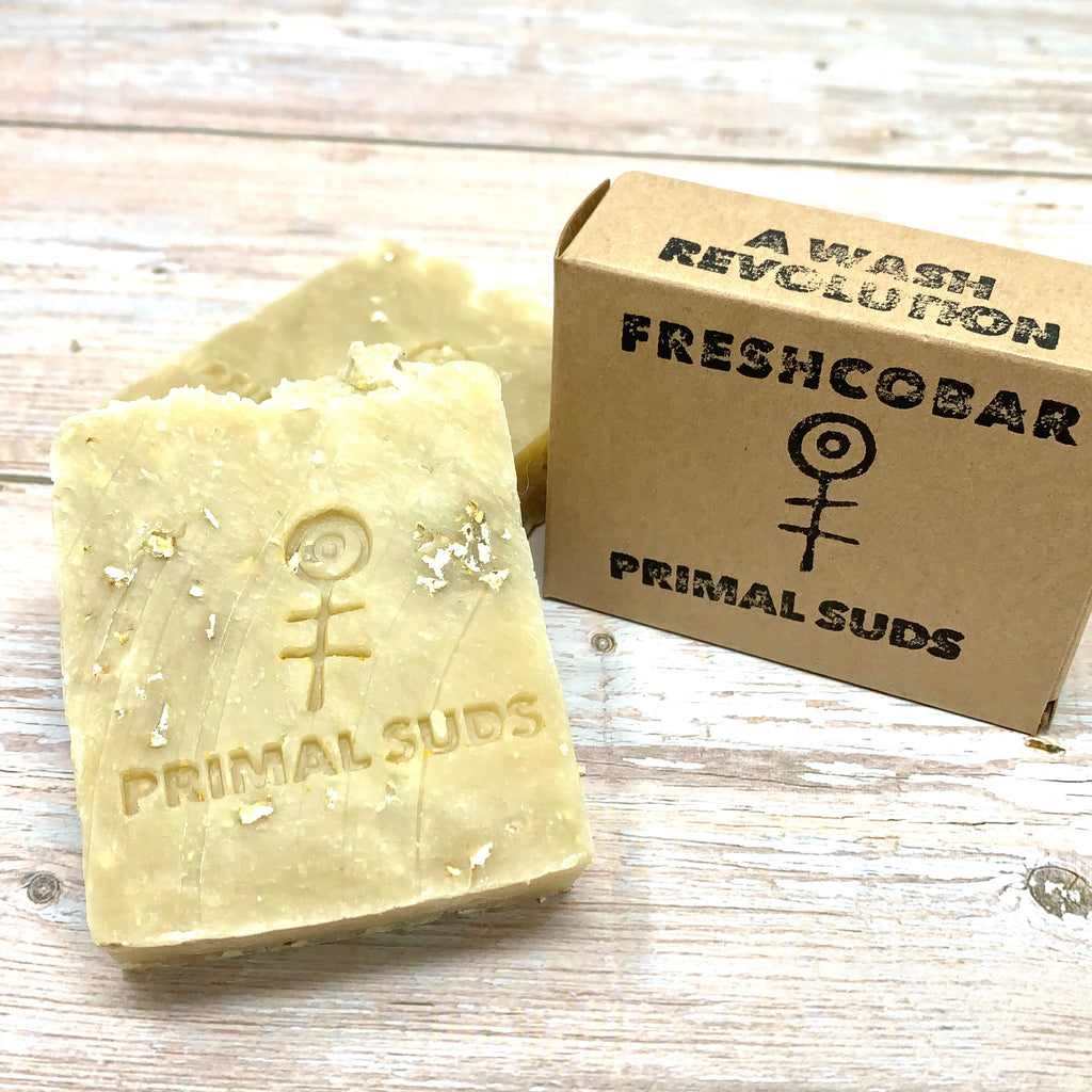 yellow vegan soap with bits of oatmeals and clay for gentle exfoliation by primal suds