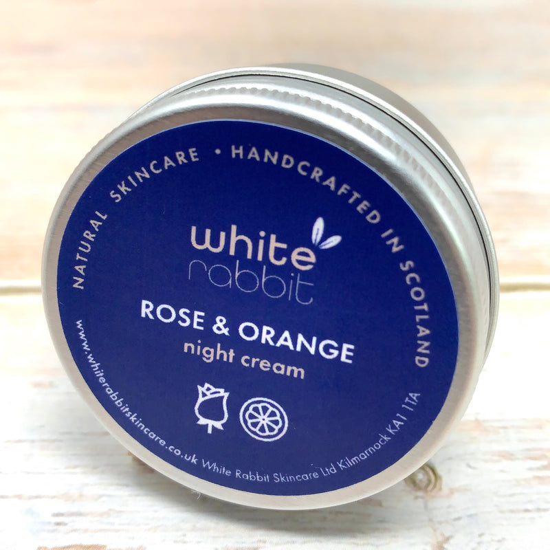 small travel pot in aluminium container of vegan night cream by white rabbit with orange and rose