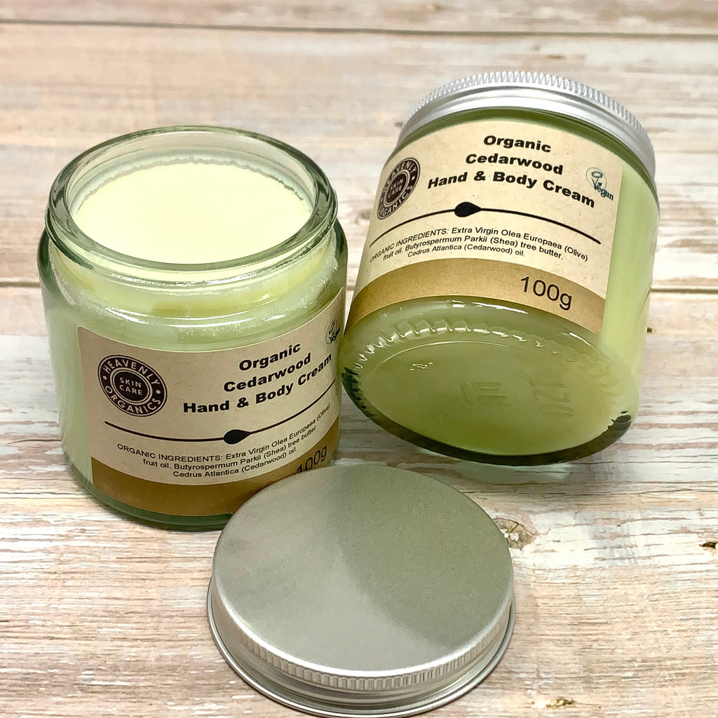 organic hand and body cream with cedarwood in glass jar and brown labels