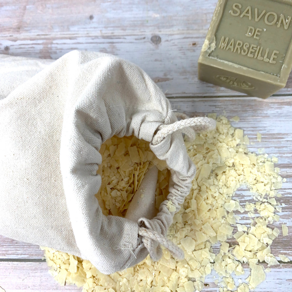 soap flakes made with natural savon de marseille in cotton bag