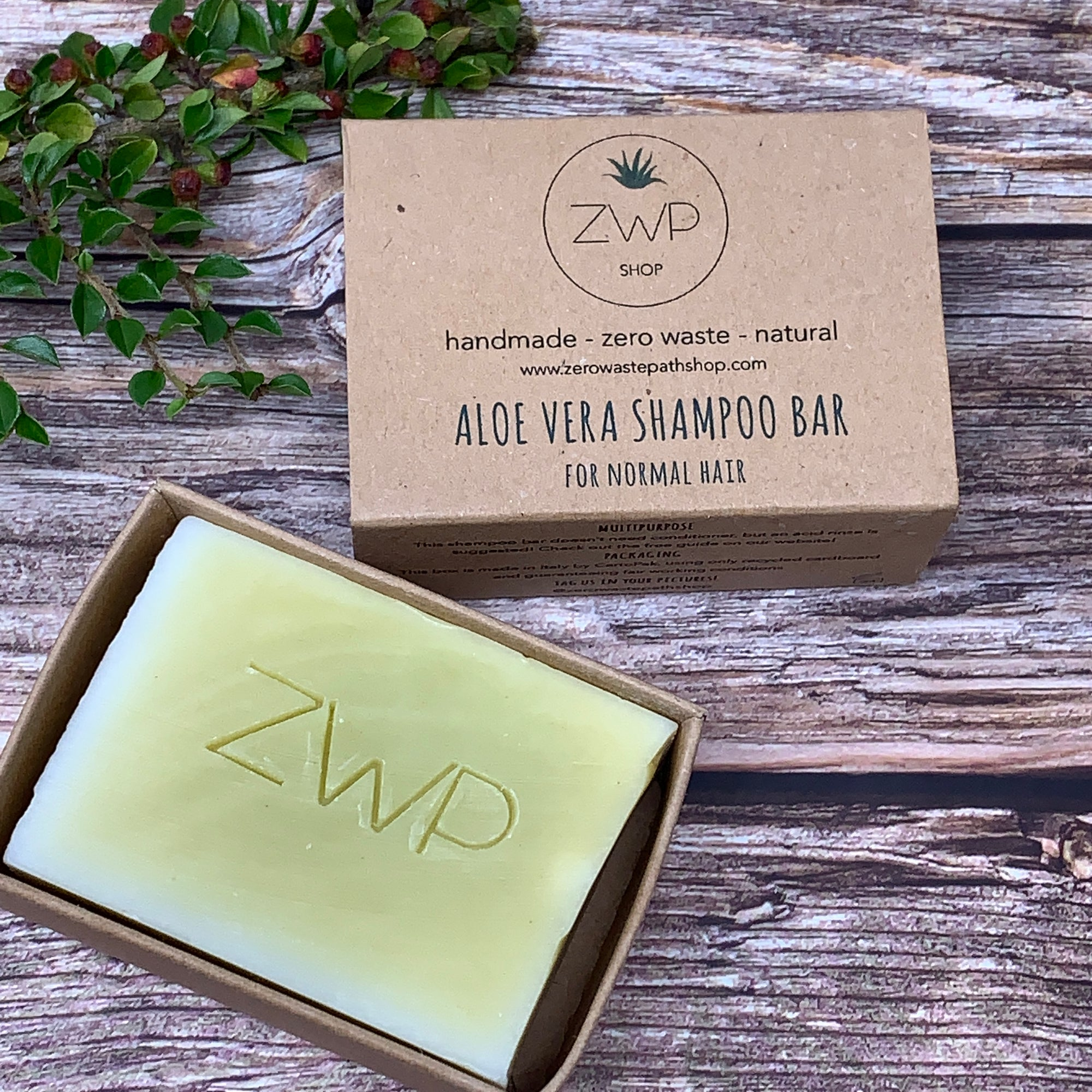 solid yellow shampoo bar with ZWP logo engraved  and brown box without plastic