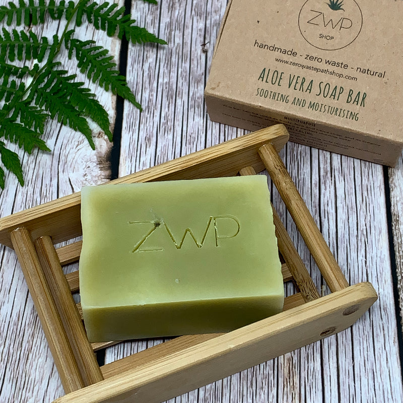 aloe vera green soap bar placed on a handmade bamboo soap dish