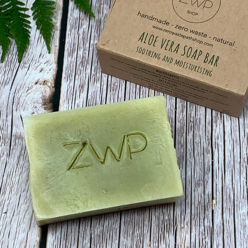 front side of zero waste path aloe vera soap bar for sensitive skin and front of the packaging box