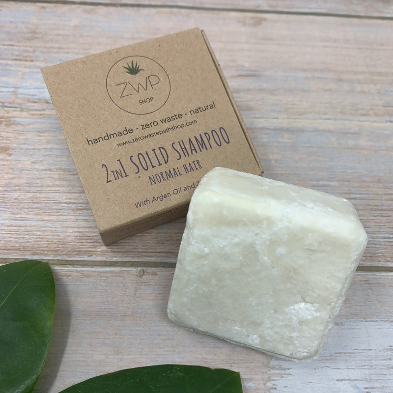 white solid shampoo and conditioner bar with plastic free packaging in brown paper