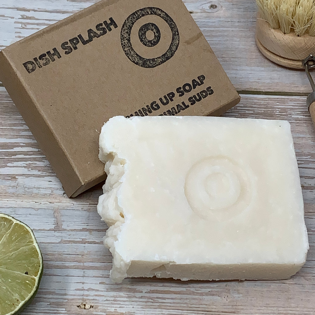 "white natural washing up soap by primal suds with box made of recycled brown paper and writing ""dish splash"" on the front side"