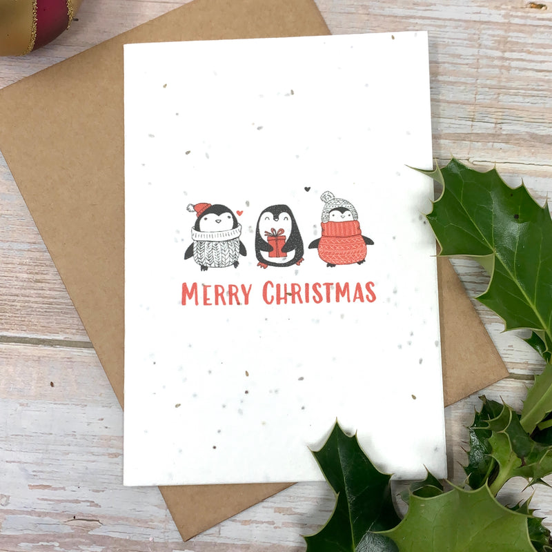 merry christmas ecofriendly card with penguins and seeds to grow flowers