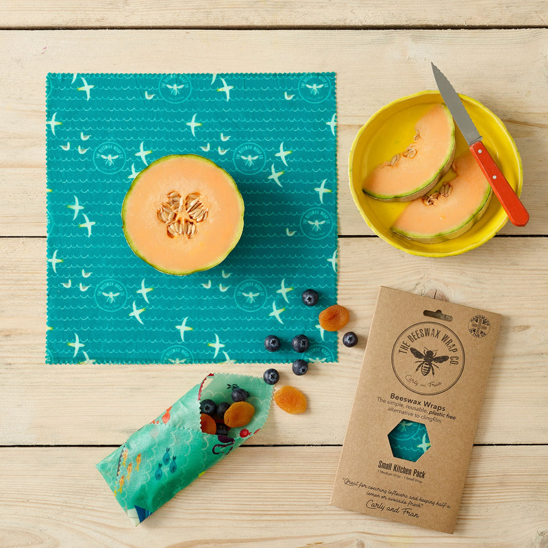 pumpkins and berries wrapped into blue and green organic beeswax wraps
