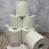 8 while toilet paper rolls stacked on top of each other, and one roll with loose paper