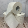 three eco-friendly white paper toilet rolls