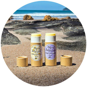 2 Natural Herbal Deodorants on a beach in New Zealand