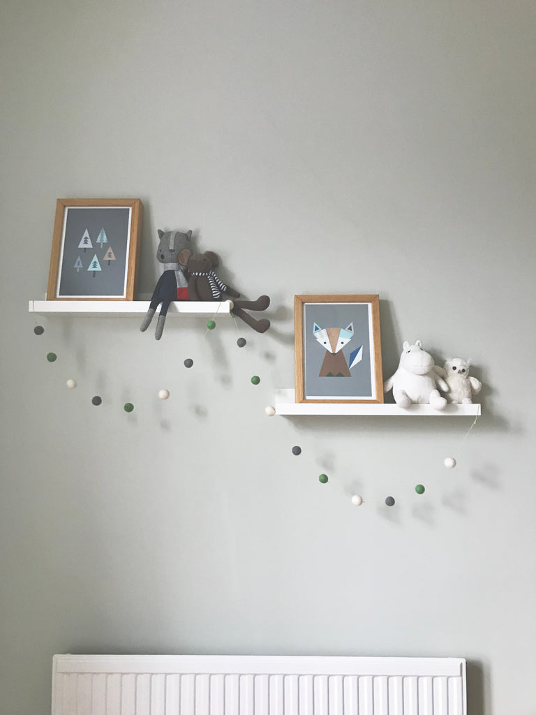 Scandinavian style nursery with wall art, soft toys and pom poms. Otis and The Wolf bringing you scandi inspired design for babies, toddlers and children for the modern nursery