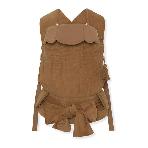 Baby carrier is almond colourwat from Danish design house Konges Slojd. THis stylish baby sling carrier brings both comfortm support and style for parents and baby. Suitable from birth to toddler age