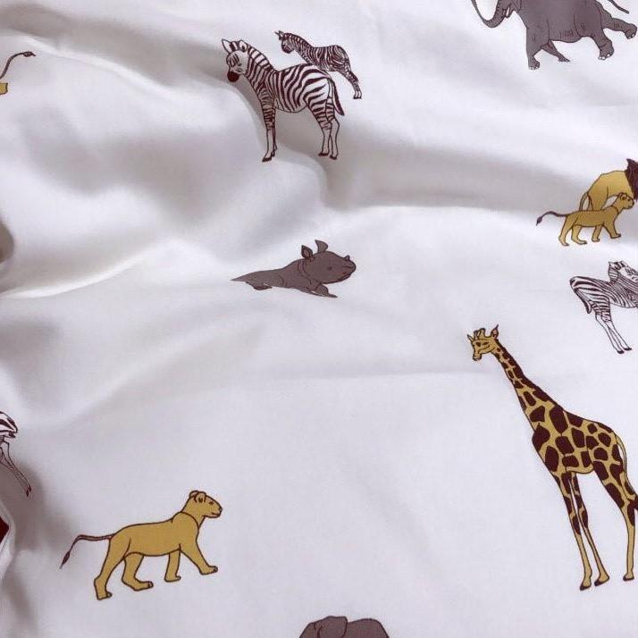 Safari Print Bed Linen from Danish brand Gamcha. To fit a baby cot or junior bed and made from 100% organic cotton. The beautiful wildlife print is perfect for a safari or animal themed nursery or bedroom..