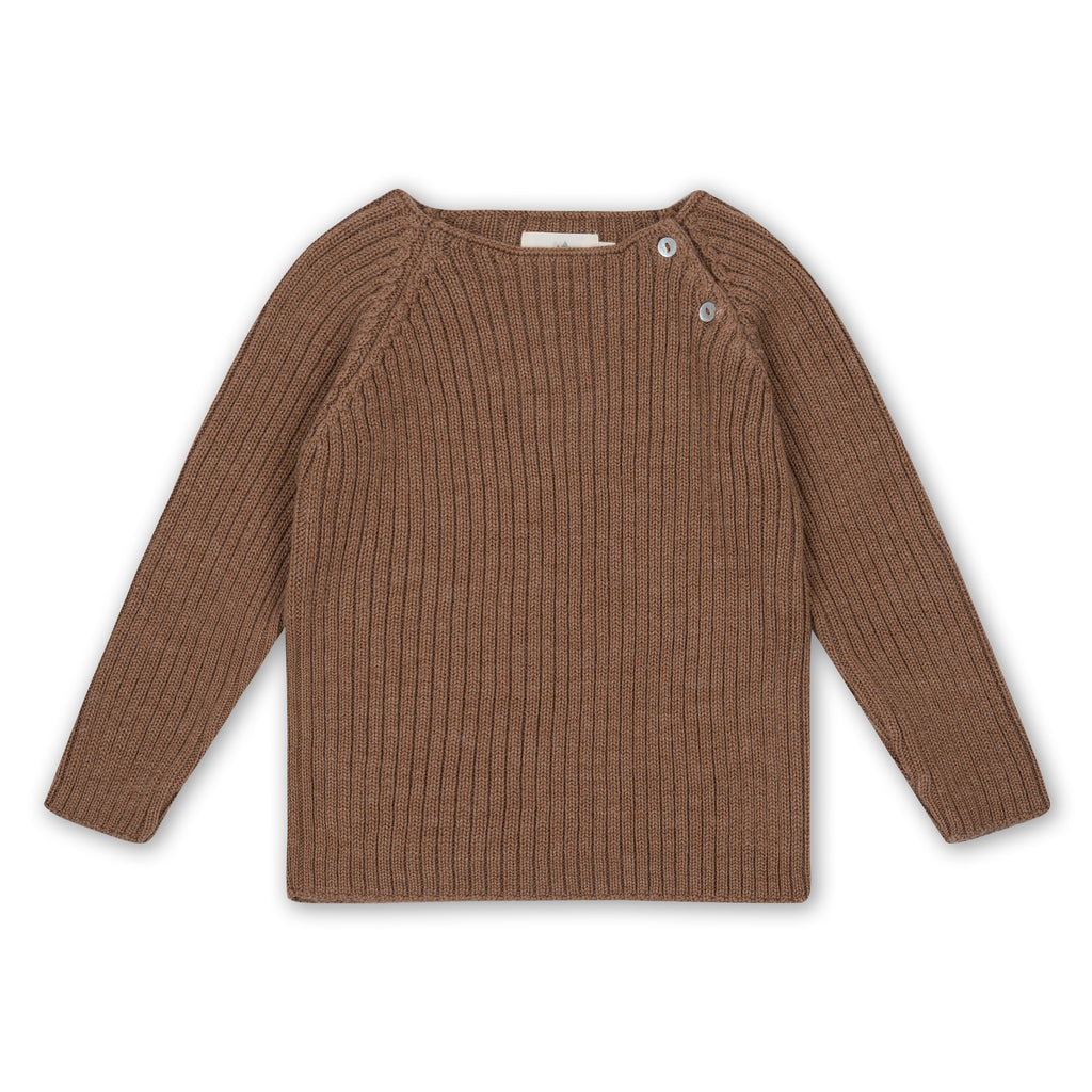 100% Merino wool ribbed jumper from Danish children's brand Konges Slojd. The wool is super-soft on delicate skin, will keep them warm on the coldest of days and the unisex almond colour will work beautfully as a staple jumper in any winter wardrobe. Otis and the Wolf - bringing you Scandi style for little ones