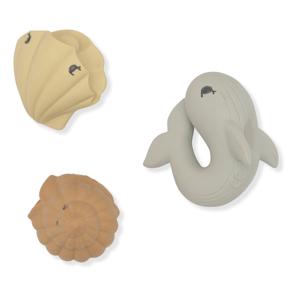 Ocean themes bath toys from Konges Slojd, The trio of natural rubber bath toys contains a whale, a shell and a clam.