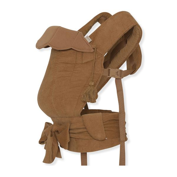 Konges Slojd Umami Baby Carrier wrap sling - in almond colour made from soft cotton corduroy. Suitable from birth with face to face, forward facing and side carrying positions.
