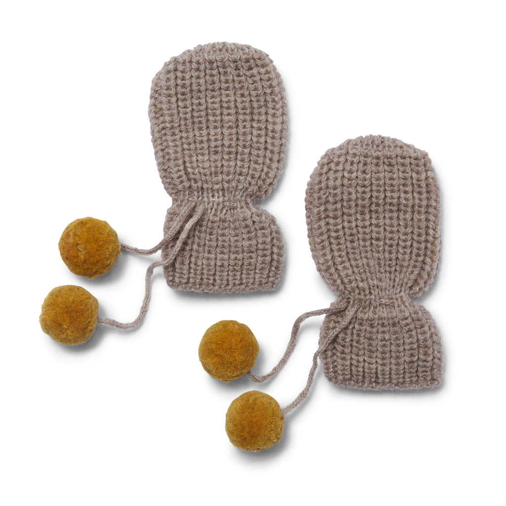 100% wool knitted baby gloves with pompom ties. Creamy white knitted mittens with mustard coloured pompom ties from Danish designer house Konges Slojd. Otis and the Wolf - bringing you Scandi style for babies and children