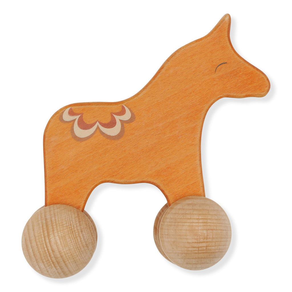 Traditional wooden toy horse on wheels from Konges Slojd. A timeless scandi design children's toy. Otis and the Wolf bringing you Scandi style for little ones and the modern home