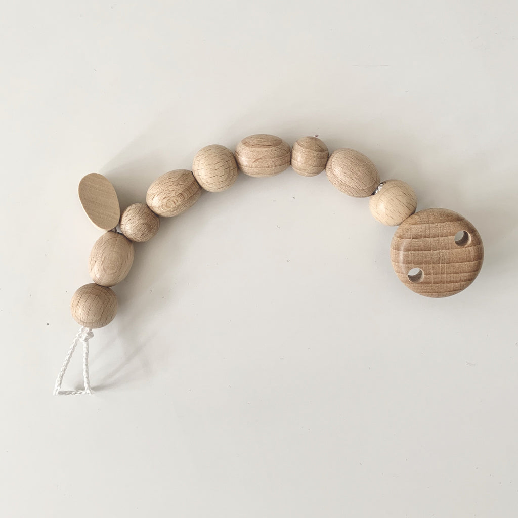 Natural Wooden Beads Soother Chain. A beautiful and natural dummy clip using sustainable untreated wood. From German brand Heimess. Otis and the Wolf - bringing you scandi style for little ones from baby essentials and toys to clothing and nursery decor