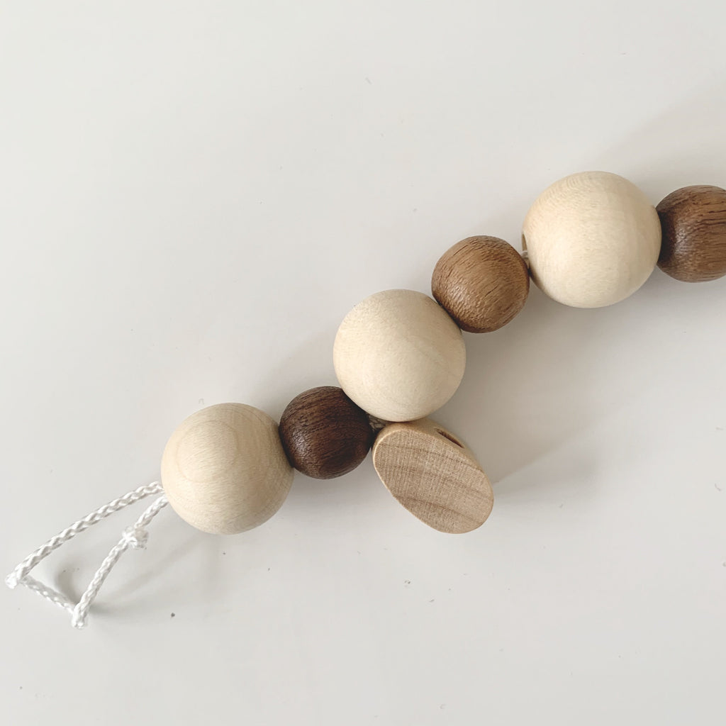 Natural wooden dummy chain with dark and light wooden beads from the Heiress Nature range - made in Germany from sustainable wood.  An untreated and beautiful pacifier chain. Otis and the Wolf bringing you scads style for little ones