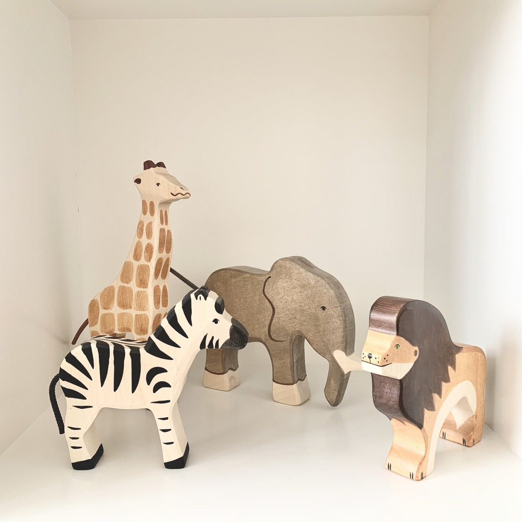 Wooden Lion Toy from German brand Holztiger. Beautifully eco-friendly and handcrafted animal from maple and beech wood and painted using non-toxic water coloured paints. Both toy and nursery decor in one - perfect for imaginary play and to sit beautifully in a safari or animal themed nursery or child's bedroom.