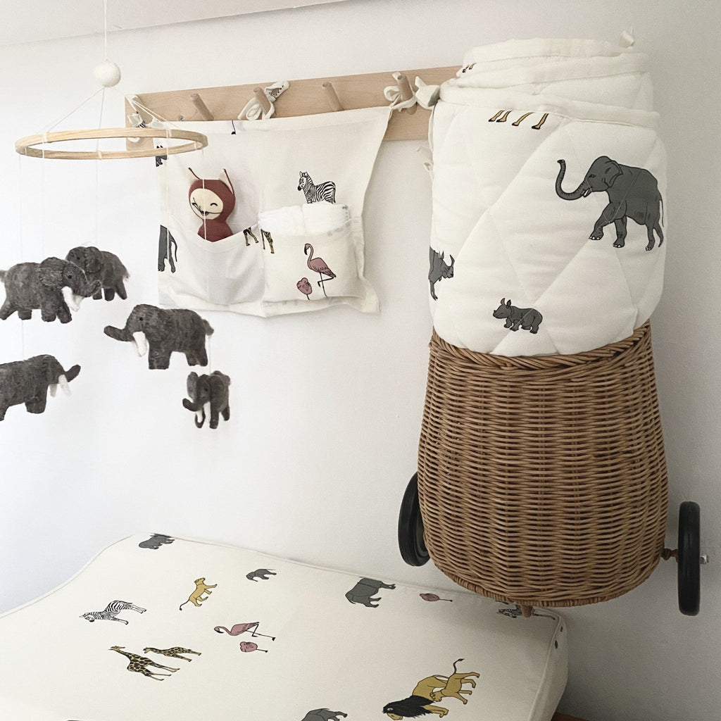 Scandinavian designed Pocket Storage with Safari print from Danish brand Gamcha. The storage bag comes with two pockets and three ties to attach to the side of a cot or to hooks. The print is made up of giraffes, elephants, flamingos, rhinos and lions - a perfect nursery essential for a safari theme bedroom. Otis and the Wolf bringing you Scandi style baby essentials and nursery decor for little ones