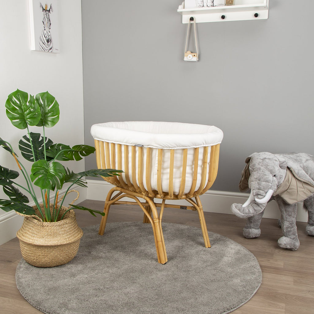 Natural rattan crib for baby nursery. The cradle comes with a mattress and white cover to keep your baby safe and protected. Otis and the Wolf - bringing you Scandi style for little ones