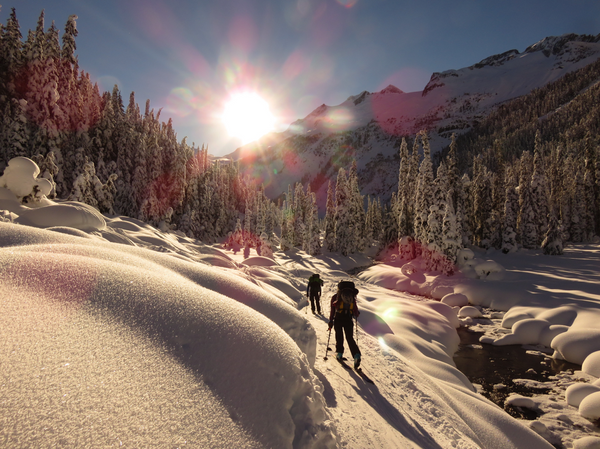 Backcountry skiing into the sun in British Columbia
