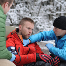 Load image into Gallery viewer, Practice assessing patient vital signs in a wilderness setting in our Wilderness First Responder Recertification courses.
