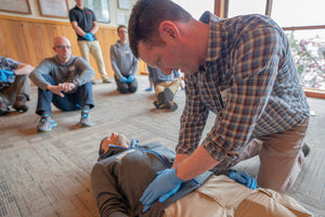 Remote EMT student learns how to perform a abdominal exam