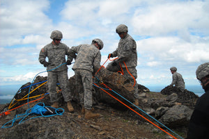 Military team practicing rope rescue
