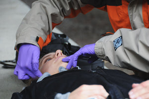Remote Medical Training Wilderness First Aid (WFA) courses teach rescuers how to manage an unconscious patient's airway.