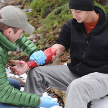 Load image into Gallery viewer, In a Wilderness First Aid (WFA) course, you will learn numerous first aid skills including how to control a wound that is bleeding.