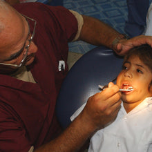 Load image into Gallery viewer, Remote EMT assessing a child's dental needs