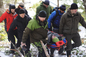 Wilderness First Aid students learn how to package and evacuate patients over adverse terrian