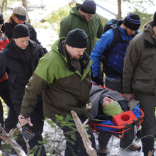 Load image into Gallery viewer, Learn how to safely move patients over adverse terrain in a Remote Medical Training Wilderness First Responder (WFR) course.