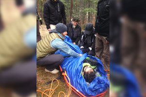 "Wilderness First Aid (WFA) students learn how to create a ""hypo-wrap"" to protect patients from the environment in Remote Medical Training courses."
