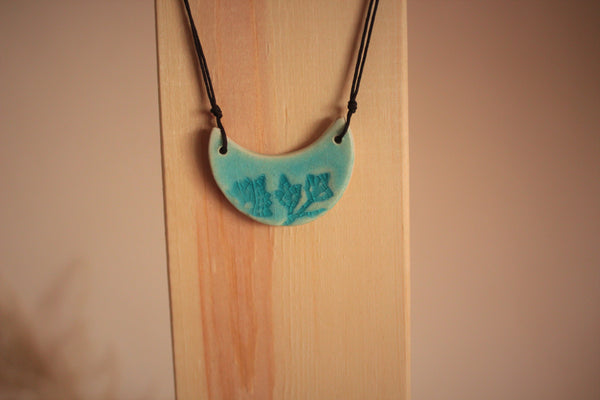 blue porcelain necklace with flowers