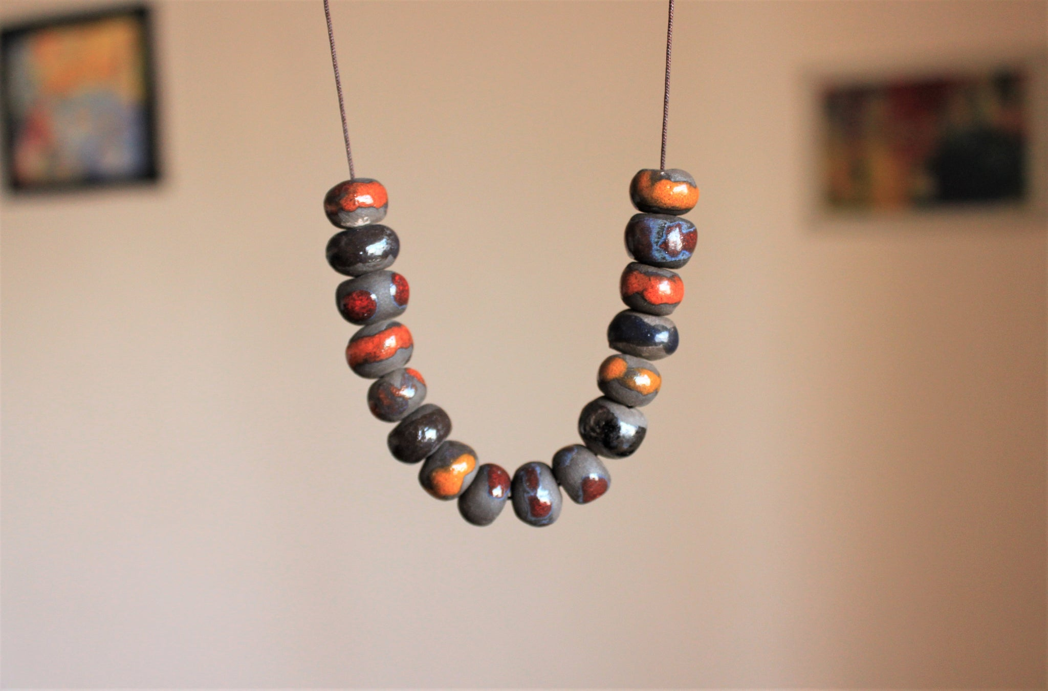 beaded black and orange porcelain necklace