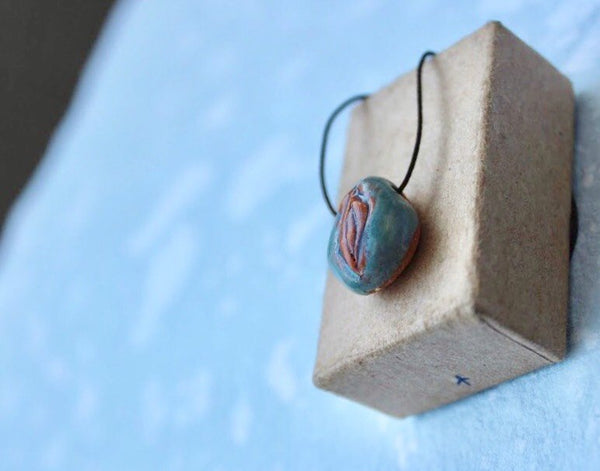 tiny blue seed porcelain pendant