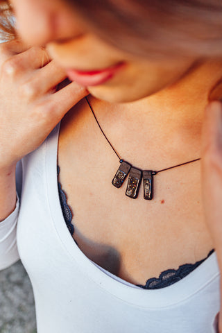 black porcelain necklace with rectangles and colorful dots