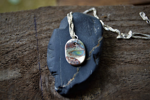 Pastel colors ceramic pendant on a silver chain