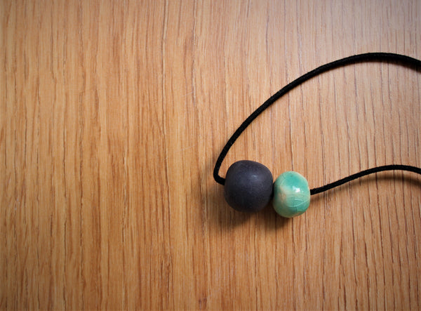 black and green porcelain necklace with two beads