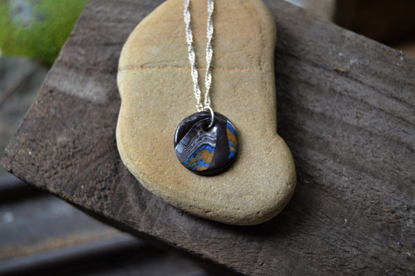 Dark colorful round porcelain pendant on a silver chain