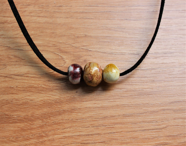 porcelain necklace with three colorful beads