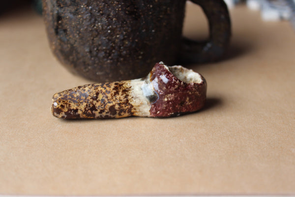 brown rustic ceramic pipe