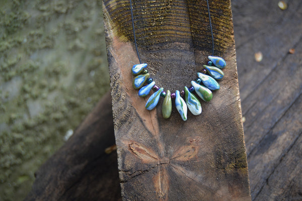Statement porcelain necklace with green and blue drops