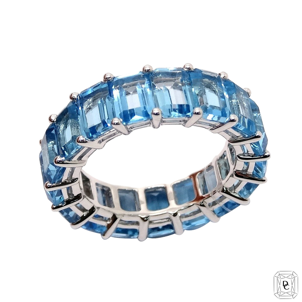 Emerald Cut Blue Topaz Eternity Ring