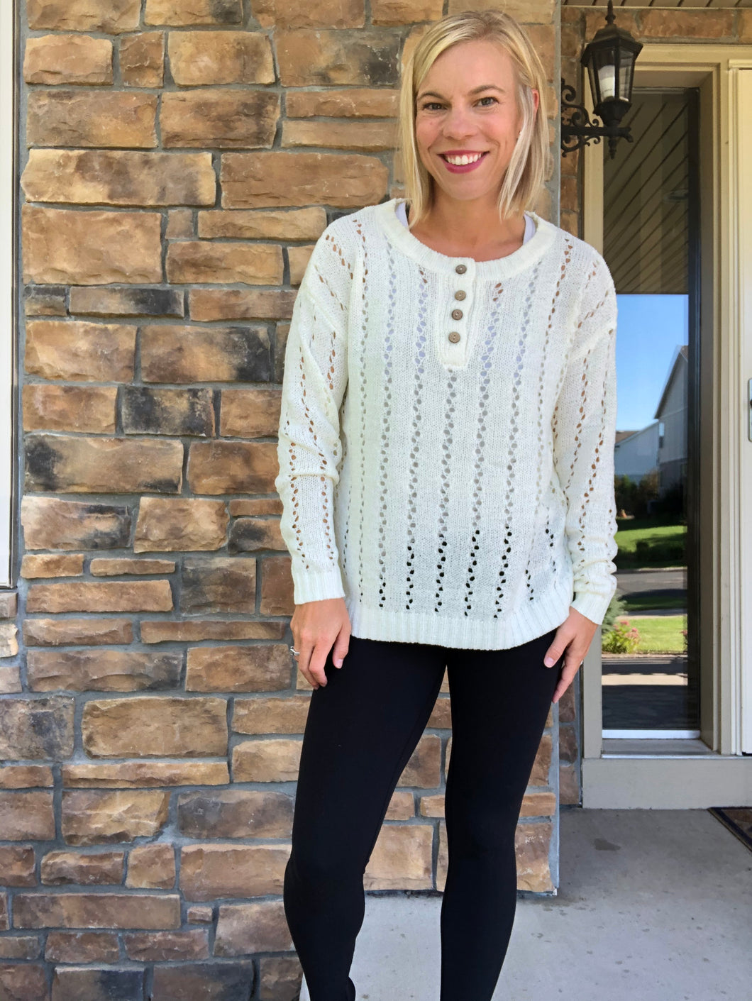 cream pullover sweater with buttons